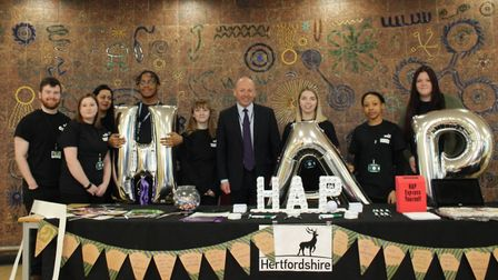 Herts County Council leader David Williams with the authority's apprentices.