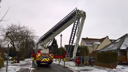 Fire crews are working on stabilising the chimney so it can be removed. Picture: David Hatton