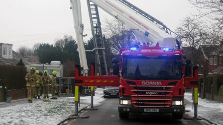 Fire crews worked for more than six hours to make the bungalow safe. Picture: Don Shewan