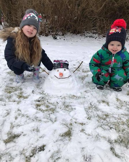 Maisie and Mario in St Albans made a mini snowman. Picture: Nicole Norman.