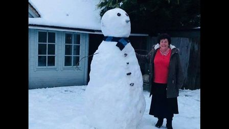 Annette with the gigantic snowman in St Albans. Picture: Nicole Norman.