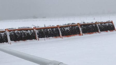 One of the hurdles at a snowbound Huntingdon Racecourse.