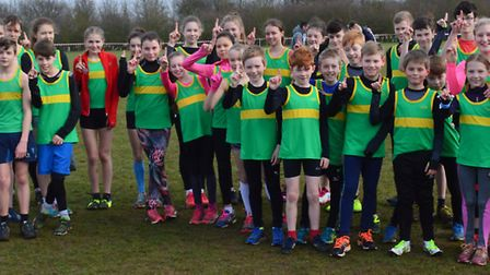 Hunts AC youngsters celebrate retaining the Frostbite Friendly League junior title. Picture: CONTRIB