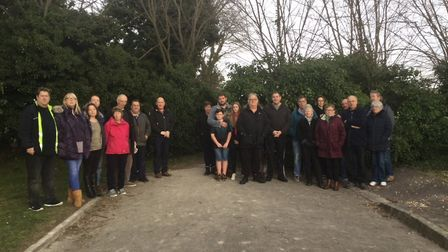 'Say No to TRO': Residents, pictured at the proposed access point in Royston's Garden Walk, say a ga