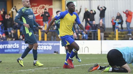 Rhys Murrell-Williamson and the Clarence Park crowd celebrate St Albans City's second goal Picture:
