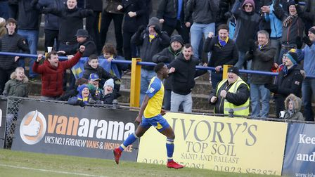 Rhys Murrell-Williamson celebrates with the St Albans City fans after scoring the second goal of the