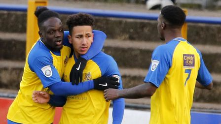 Solomon Sambou and Rhys Murrell-Williamson celebrate with Zane Banton after he converted a 92nd-minu