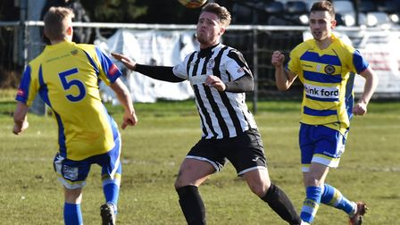 Declan Rogers uses his head for St Ives Town against Farnborough. Picture: J BIGGS PHOTOGRAPHY