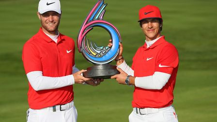 Thorbjorn Olesen and Lucas Bjerregaard of Denmark pose with the trophy after winning the final match