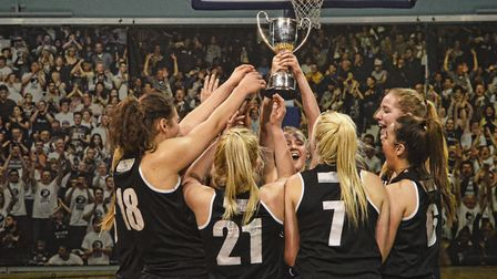 Oaklands Wolves U18s celebrate lifting the Junior National Basketball League National Cup.