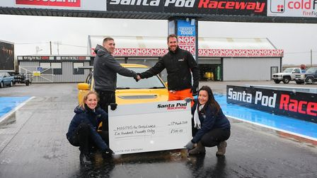 Magpas' Dr. Scott Castell (r) welcomes a donation cheque from auction winner Jordan Bradford. Pictur