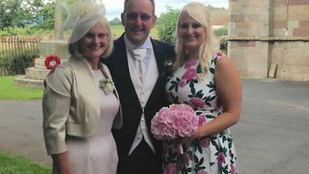 Paula Noble, left, with husband Gary and daughter Beccy at son Steve's wedding. Picture: Courtesy of