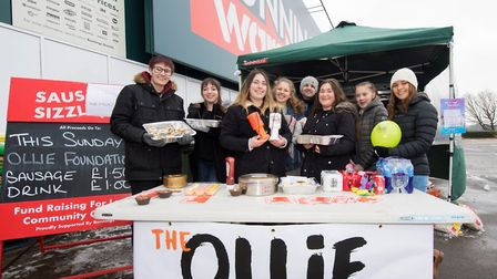 The NCS team selling cakes in aid of OLLIE.