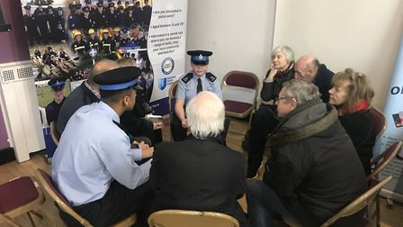 Members of the public speaking to police cadets at the workshop. Picture: Herts Constabulary.