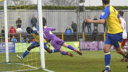Percy Kiangebeni pounces for St Albans City's late winner against Poole Town. Picture: BOB WALKLEY