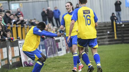 Percy Kiangebeni and St Albans City celebrate their late winner against Poole Town. Picture: BOB WAL