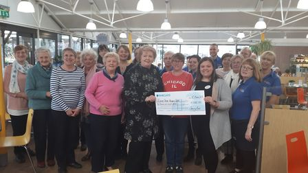 The Sewing Bee present a donation to Rennie Grove.