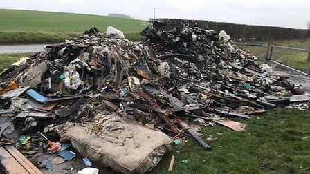 The fly-tipped rubbish dumped on Rectory Farm in Great Chishill was set on fire. Picture: Robert Law