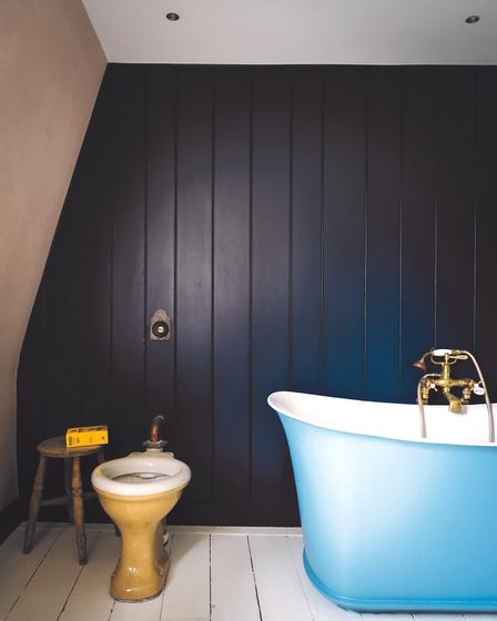 Bathroom: The deep hues from Farrow & Ball adds a sense of drama, when contrasting with the pale flo