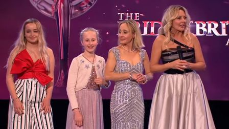 Sarah and her daughters on TV. Left to right: Sapphire, Pollyanna, Sarah, Carol Vorderman .