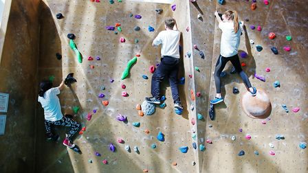 The Herts Advertiser reporters try their hand at bouldering during a climbing taster session with We