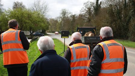 Members of the Brampton Speedwatch team monitorr the readings as vehicles pass
