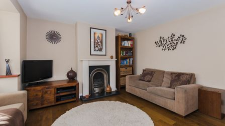 The large lounge has a box bay window to the front aspect, solid wood flooring and a feature firepla