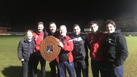 The management team at Colney Heath celebrate with the Herts Charity Shield. Picture: NICK SANDERS