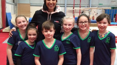 Henni Goya pictured with pupils Sophia, Kasia, Sid, Jessical, Holly and Alice.