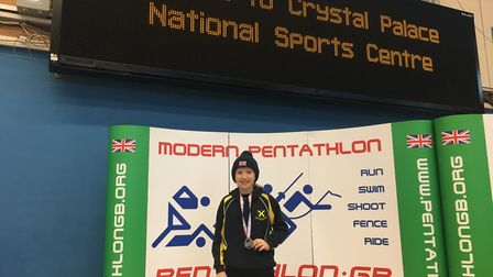 Raissa Vickery with her silver medal after the 2018 British Schools' Modern Biathlon Championships.