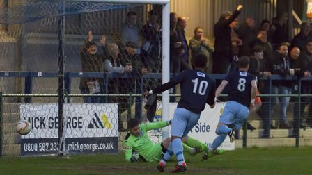 David Bridges (8) sets off in celebration after giving St Neots Town an early lead against St Ives T