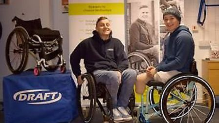Billy Monger, right, in his new chair with Steve Kenyon, from Draft Wheelchairs