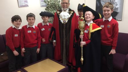Dylan Chisholm and his friends met Mayor Mohammad Iqbal Zia at St Albans district council offices.