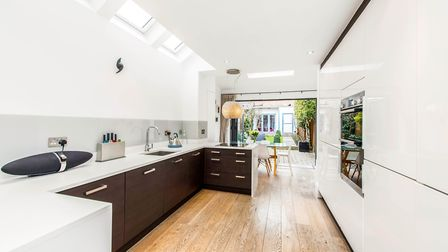 The open plan kitchen/dining/family room opens up via bifold doors to the garden