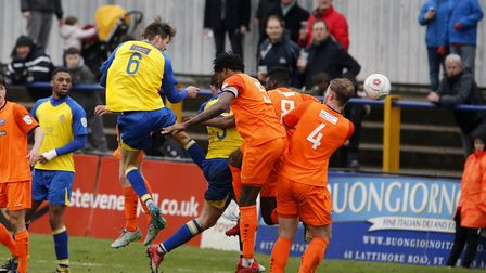 Tom Gardiner powers a header towards goal. Picture: LEIGH PAGE