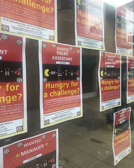 Posters in the window of the empty shops