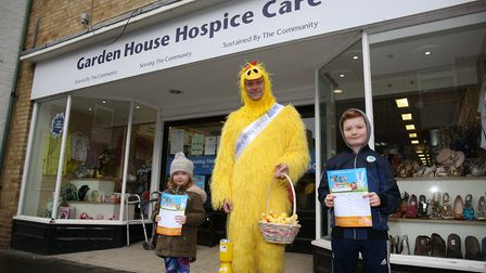 Freya and Harry McDonough with the Garden House Hospice chicken in Royston Town centre. Picture: DAN