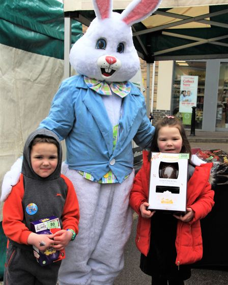 Ava and Bertie Fowle with the Easter bunny. Picture: Clive Porter