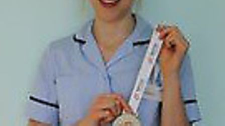 Jess Williams with her gold medal