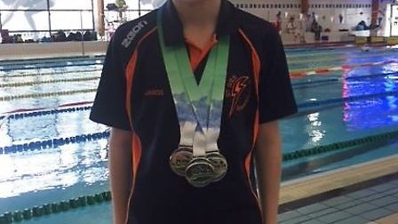 Janos Kadar won three gold medals for St Ives Swimming Club.