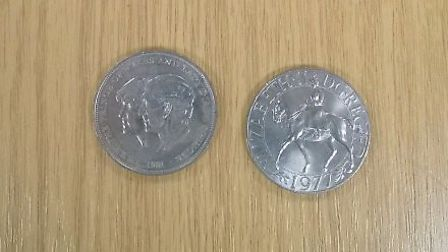 Silvery coins recovered from Oysterfields by police. Photo: Herts Police.