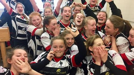 Harpenden U15 girls' celebrate their victory over Ellingham & Ringwood in the Area Two final.