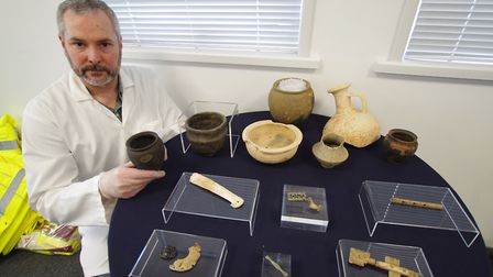 Finds supervisor Jim McKeon with some of the finds discovered during work on the A14