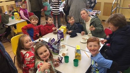Enjoying the Easter eggs after the Therfield hunt. Picture: Therfield First School