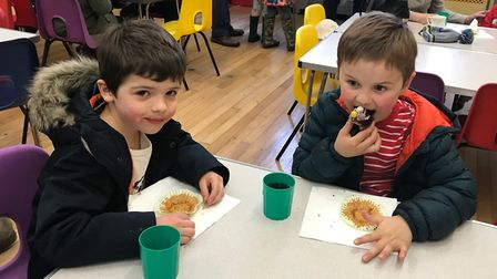 Calum Henderson and Ben Ellis enjoy cake after the Therfield hunt. Picture: Therfield First School