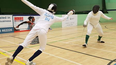 ARU's Luis Oliveira attacks Ian Coates of Huntingdonshire Fencing Club with a dynamic fleche. Pictur