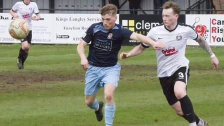 Stefan Broccoli of St Neots Town holds off an opponent at Kings Langley. Picture: CLAIRE HOWES