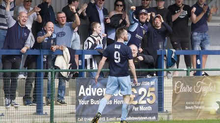 Tom Meechan celebrates his goal in front of fans as St Neots Town beat Redditch. Picture: CLAIRE HOW