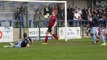 The opening goal for St Neots Town - scored with a helping hand from Redditch defender Tom Fishwick.