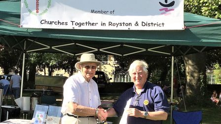 Brian Norwood of Royston Methodist Church in Queens Road presents Rotary's David Izod with the resul
